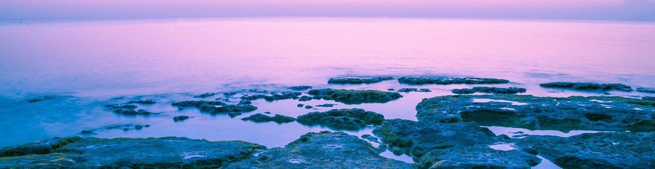 Water with rocks. A purplish hue.